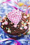 A chocolate cupcake topped with a pink heart for a party Stock Photo - Premium Royalty-Freenull, Code: 659-06902087