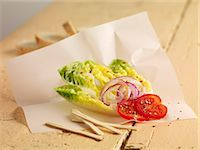 Lettuce hearts with onions and tomatoes Stock Photo - Premium Royalty-Freenull, Code: 659-06902308