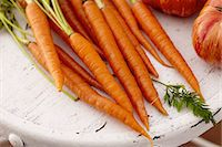 Carrots and Tomatoes on a Distressed White Table Stock Photo - Premium Royalty-Freenull, Code: 659-06902871