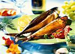 Smoked fish with tomatoes and lemon Stock Photo - Premium Royalty-Freenull, Code: 659-06903473