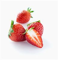 strawberries - Strawberries, whole and halved Stock Photo - Premium Royalty-Freenull, Code: 659-06903547