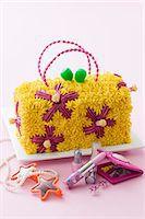 A child's birthday cake (a handbag with a flower design) Stock Photo - Premium Royalty-Freenull, Code: 659-06903698
