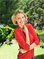 Portrait of a smiling woman posing Stock Photo - Premium Royalty-Freenull, Code: 6108-06904479
