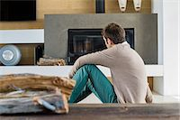 sweater and fireplace - Man sitting in front of a fireplace at home Stock Photo - Premium Royalty-Freenull, Code: 6108-06904579