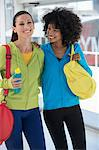 Two happy female friends carrying gym bags Stock Photo - Premium Royalty-Free, Artist: Uwe Umstätter, Code: 6108-06904631