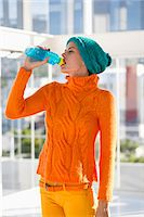 Woman drinking water from a bottle Stock Photo - Premium Royalty-Freenull, Code: 6108-06904732