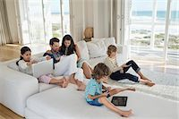 Family using electronics gadget Stock Photo - Premium Royalty-Freenull, Code: 6108-06904850