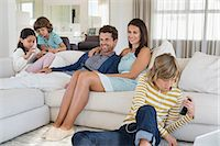 preteen family - Family using electronics gadget Stock Photo - Premium Royalty-Freenull, Code: 6108-06904869