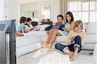 preteen family - Family using electronics gadget Stock Photo - Premium Royalty-Freenull, Code: 6108-06904909