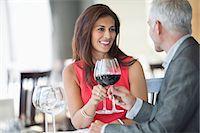 Couple enjoying red wine in a restaurant Stock Photo - Premium Royalty-Freenull, Code: 6108-06904985