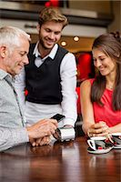 person on phone with credit card - Waiter showing credit card reader to a couple on a table in a restaurant Stock Photo - Premium Royalty-Freenull, Code: 6108-06904988