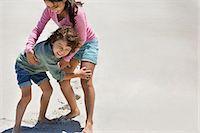 Children playing on the beach Stock Photo - Premium Royalty-Freenull, Code: 6108-06905327