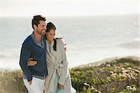 Couple walking on the beach Stock Photo - Premium Royalty-Freenull, Code: 6108-06905456