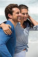 Close-up of a happy couple on the beach Stock Photo - Premium Royalty-Freenull, Code: 6108-06905476