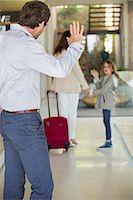 Man waving to his daughter leaving home Stock Photo - Premium Royalty-Freenull, Code: 6108-06905736