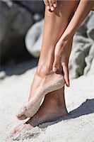 female feet close up - Woman cleaning sand of her feet Stock Photo - Premium Royalty-Freenull, Code: 6108-06905800