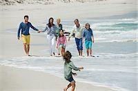 Family enjoying on the beach Stock Photo - Premium Royalty-Freenull, Code: 6108-06905907