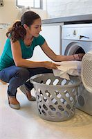 Woman doing laundry at home Stock Photo - Premium Royalty-Freenull, Code: 6108-06905959