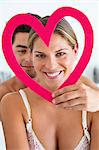 Couple with a heart shape object Stock Photo - Premium Royalty-Free, Artist: Blend Images, Code: 6108-06906233
