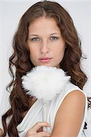 feather  close-up - Portrait of a woman holding a feather duster Stock Photo - Premium Royalty-Freenull, Code: 6108-06906344