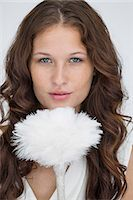 feather  close-up - Portrait of a woman holding a feather duster Stock Photo - Premium Royalty-Freenull, Code: 6108-06906367