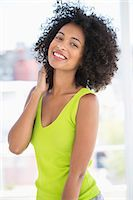 Portrait of a woman smiling Stock Photo - Premium Royalty-Freenull, Code: 6108-06906496