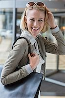 Portrait of a beautiful woman smiling Stock Photo - Premium Royalty-Freenull, Code: 6108-06906501