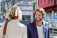 flirting - Man flirting a woman and smiling Stock Photo - Premium Royalty-Freenull, Code: 6108-06906517