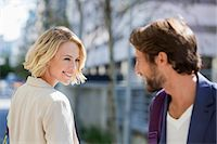 flirting - Man and woman smiling at each other Stock Photo - Premium Royalty-Freenull, Code: 6108-06906587