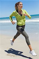 Woman jogging on the beach Stock Photo - Premium Royalty-Freenull, Code: 6108-06906589