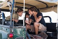 Three friends in SUV Stock Photo - Premium Royalty-Freenull, Code: 6108-06906839