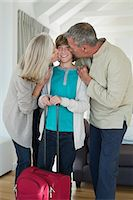 preteen kissing - Grandparents kissing their grandson at home Stock Photo - Premium Royalty-Freenull, Code: 6108-06906847