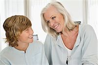 Woman and her grandson smiling at each other Stock Photo - Premium Royalty-Freenull, Code: 6108-06906867
