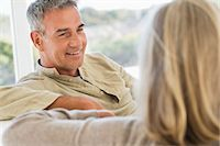 Close-up of a senior couple sitting on a couch Stock Photo - Premium Royalty-Freenull, Code: 6108-06906899
