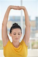 stretching (people exercising) - Close-up of a woman exercising in a gym Stock Photo - Premium Royalty-Freenull, Code: 6108-06906935