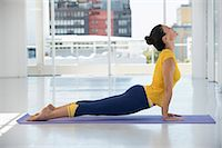 Woman exercising on exercise mat in a gym Stock Photo - Premium Royalty-Freenull, Code: 6108-06906939