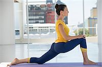 stretching (people exercising) - Woman exercising on exercise mat in a gym Stock Photo - Premium Royalty-Freenull, Code: 6108-06906952