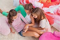 preteen touch - Three girls using a mobile phone at a slumber party Stock Photo - Premium Royalty-Freenull, Code: 6108-06907035