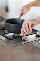 stove - Woman cooking in the kitchen Stock Photo - Premium Royalty-Freenull, Code: 6108-06907095