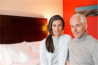 Portrait of a couple sitting in a hotel room Stock Photo - Premium Royalty-Freenull, Code: 6108-06907152