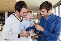 Parents with their son at home Stock Photo - Premium Royalty-Freenull, Code: 6108-06907321