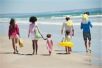 people and vacation - Family walking on the beach Stock Photo - Premium Royalty-Freenull, Code: 6108-06907573