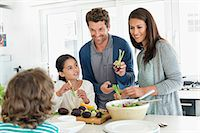 Family preparing food in the kitchen Stock Photo - Premium Royalty-Freenull, Code: 6108-06907607