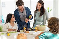 Family preparing food in the kitchen Stock Photo - Premium Royalty-Freenull, Code: 6108-06907623