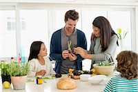 Family preparing food in the kitchen Stock Photo - Premium Royalty-Freenull, Code: 6108-06907634