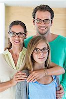 Portrait of a family wearing eyeglasses and smiling Stock Photo - Premium Royalty-Freenull, Code: 6108-06907639