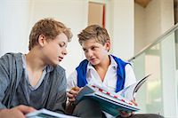 Two teenage boys studying in a school Stock Photo - Premium Royalty-Freenull, Code: 6108-06907664