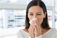 people coughing or sneezing - Close-up of a woman sneezing Stock Photo - Premium Royalty-Freenull, Code: 6108-06907760