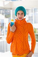 Portrait of a woman holding a water bottle Stock Photo - Premium Royalty-Freenull, Code: 6108-06908070