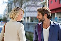 flirting - Man and woman smiling at each other Stock Photo - Premium Royalty-Freenull, Code: 6108-06908139